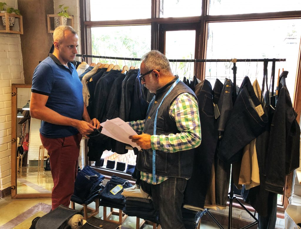 Shyam Sukhramani, founder of Korra taking client measurements for custom selvedge jeans